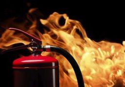 fire extinguisher on black background
